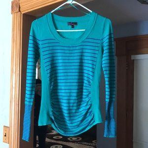 Green and purple striped long sleeve shirt